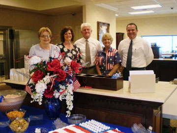 Pictured here are (l - r)  Joyce Yaeger, member of The Crab-Orchard Chapter DAR, Pam Winningham, First National Bank Customery Service Representative,  Larry Henson, First National Bank President, Emmy Edwards, member of the Crab-Orchard Chapter DAR and Greg Pugh, First National Bank Vice President.