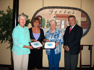 Dottie Belvo (far left) and Becky Pittman (3rd from left) volunteered as Kids on the Rise Storybook Readers for a combined 20 years service. Cheryl Richardson represented the Cumberland County School System along with KOTR Executive Director Gene Skipworth for the presentation.""