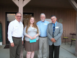 Kids on the Rise express gratitude to Administrative Assistant Megan Watson for her pastservice. Pictured (l - r) KOTR Incoming president Nick Katovitch, Megan Watson, Outgoing president Richard Holton, and Executive Director Gene Skipworth.