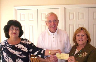 Carolyn Spencer & Carolyn O'Neal of Neighbors & Newcomers present the club's donation to John Ranger, Chairman of the local chapter of NAMI.