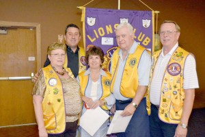New Lions Club members were inducted last week. Pictured (left to right) are: Sponsor Diane Mundt, President Dan Richardson, new members Nancy and James Hulsebus and sponsor Fred Mundt.