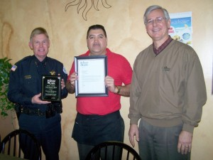 Fairfield Glade Community Club General Manager Bob Weber, right, and Public Safety Chief Randy Hoover, left, are pictured presenting a Good Samaritan plaque of recognition and a grateful 'thank you' to Santana Rodriguez. Chief Hoover also said LaCosta Restaurant server, Maria, assisted Mr. Rodriguez in the serious situation.