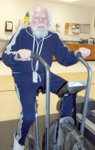 Ninety-year-old George Anderson rides a stationary bicycle at the Cumberland Medical Center Wellness Complex at Fairfield Glade.