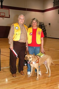 "Leader Dog ""Norman"" and his blind companion, Donna Taylor, right."