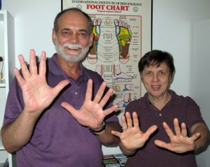 Terry and Delores Owens show off the hands that have provided therapuetic relief for 10 years.