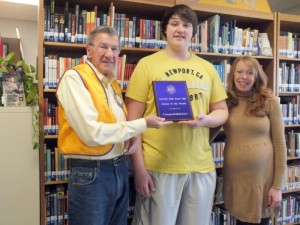"Dakota Tillman (center) becomes the ""Student of the Month"" for April. Lion Jerry Hobbs, left, and Counselor Breanna Van Winkle congratulate Dakota for his selection."