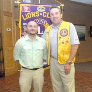New Lion member Nick Reed (left) is welcomed into the Fairfield Glade Lions Club by President and sponsor Dan Richardson.