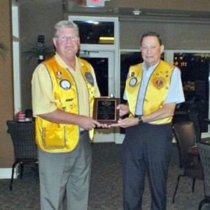 "Above, Marty Smith receives his ""Lion of the Year"" Award from Byron Buell."