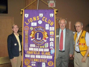 "District Governor Barbara Blansett, left, and International Director Bob Corlew, center, congratulate PDG Keith Pontius for receiving the ""Ambassador of Goodwill Award"". This is the highest award that the  International President can make to a member for Lionism service."
