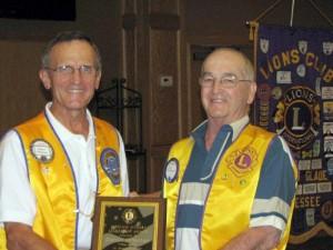 "Darryl Wharton (L) receives 2013 ""Virginia Lindsey Leadership Award"" from last year's winner, Bill Rorabaugh. tors. President Marty Smith is shown far right."