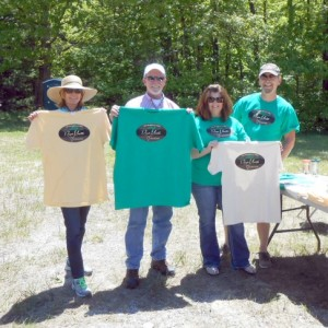 Libby Patterson, Garry Bickel, Suzette Diane and Patrick Marlin show off the Renegade Mountain logo items.