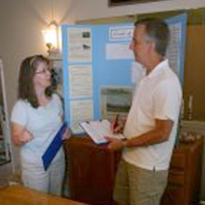 Cathy Tipton, left, discusses petition signing with committee member Richard Albins.  The group has collected over 1,200 signatures asking that Peavine Road be designated as a Scenic Parkway.