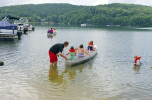 Children ages 7 to 13 participated in the Fairfield Glade Youth Boat Camp at Dartmoor Marina last week, receiving instruction from Fairfield Glade Community Club Pool and Parks Supervisor Nick O'Neal (wearing black shirt in photos). The youngsters received instruction on water safety and boat operation.