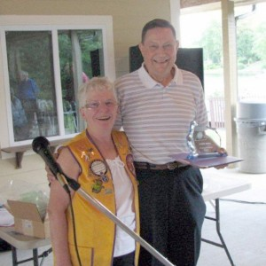Byron Buell receives the 2013 Lindsey-Jennings Fellow Award from last year's winner, Charlene Richardson.