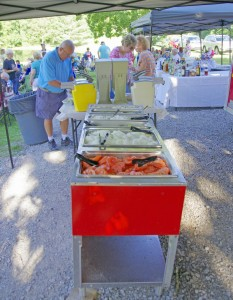 COOL CONVERTED HOT TUB — Seen above, after serving at Legends as a food heating unit for 15 years, this red unit has been resurrected by Larry and Roger Pickett of Fairfield Glade and now serves proudly as a new condiment cooler used in the Mirror Lake Concerts (photo on top).  Cost saving is an estimated $6,000.