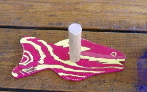 FISHY SMILES — Above, condiment fish holders at the Lake St. George Sunday fish fry bring instant smiles – and convenience.  Thirty of our fish friends were cut from scrap plywood and are used to make paper towel rolls easily available.