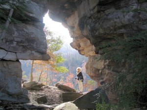Karla Miller pauses under the Lilly Arch during a previous hike near Wartburg.
