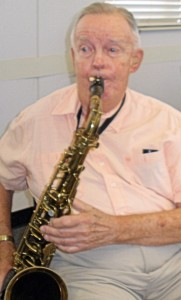 Joe Rice brought his saxophone to the party to entertain other club members.
