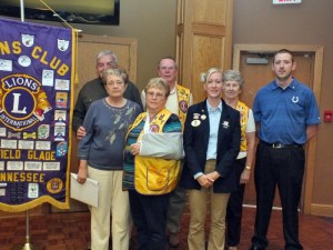 Pictured (L-R) are new Lion members Jay and Judy Paemel with Sponsors Diane and Fred Mundt, District 12-0 Governor Barbie Blansett who performed the initiation and Sponsor Carol Pontius and new member Lonnie Hinds.