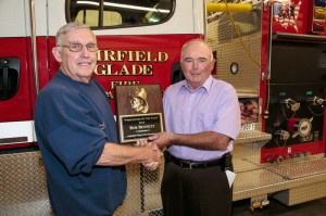 Fairfield Glade Fire Department Chief Howard Robb presents Captain Bob Bennett with the Firefighter of the Year award.