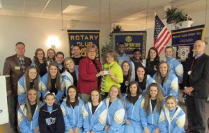 At left, the CCHS cheerleaders receive a check to help them to compete at the National Championships at Disney World in Orlando this past weekend. Above, Dwight Wages of the Southern Stars Symphonic Brass receives a check from Rotary President Chris Celik for the Lonely Instruments for Needy Kids program.