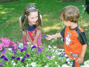 Young participants at the annual Glade Hospice Auxiliary Butterfly Release express wonder at the lovely living creatures as they awaken and fly to the nearest flowers.