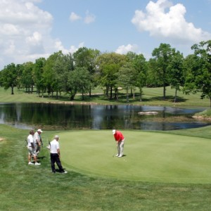 From left to right, Greg Guinn Rob Long and Mark Houser watch fellow State Senior Open competitor Bob Walcott putt at the 18th at Stonehenge Golf Club. Randy Helton (right) captured the first place trophy and $7,500 winner's check.