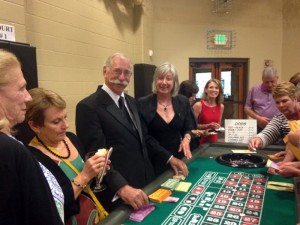Rotarian Bruce Horn and Mary Jane Ware man the popular roulette table in the casino.
